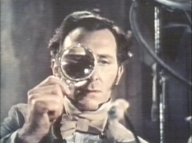 Peter Cushing and magnifying glass
