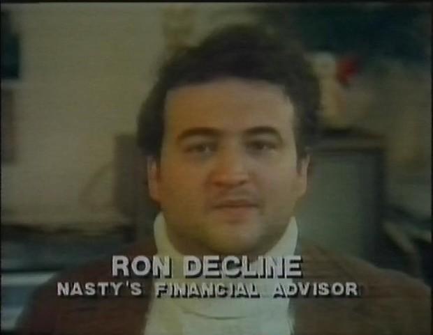 John Belushi as Ron Decline