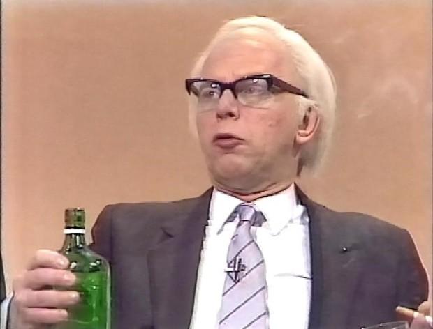 John Wells as Denis Thatcher