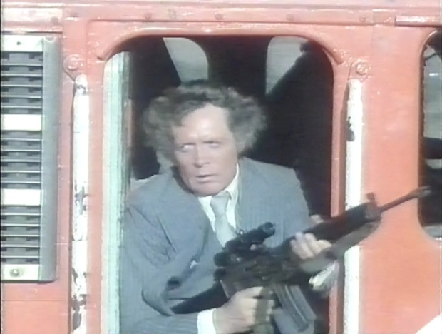 Patrick McGoohan with a gun