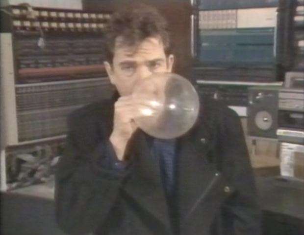 Peter Gabriel inflates a condom