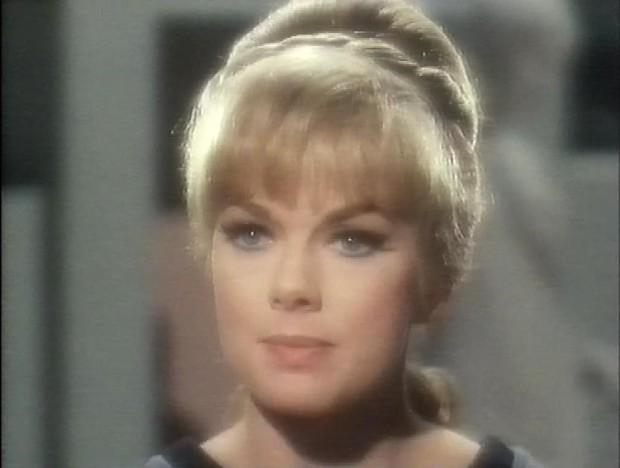 Leslie Parrish as Carolyn Palamas